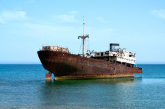 Rusty boat stranded on the shore in Lanzarote Royalty Free Stock Image
