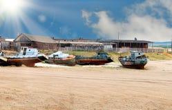 Rusty  boats. Ashore under sunlight Royalty Free Stock Photos