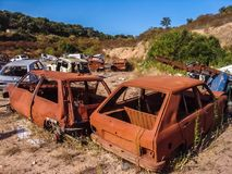 Rusty body cars in a junkyard on a sunny day royalty free stock photo