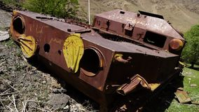 The rusty body of a tank. A hand held, medium shot of the rusty body of an abandoned war tank stock footage