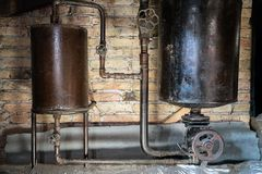 Rusty boiler room pipes. Old metal boiler generating heating and delivering it to home through pipeline. Hot water or gas is being. Delivered with this system royalty free stock images