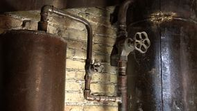 Rusty boiler room pipes. Old metal boiler generating heating and delivering it to home through pipeline. Hot water or gas is being. Delivered with this system stock video