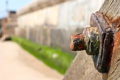 Rusty bolt. Rusty nut and bolt on a wooden beam at an essex beach Stock Photos