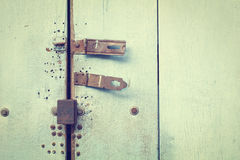 Rusty bolt on blue wooden door Stock Images