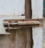Rusty bolt on decay white wooden door Royalty Free Stock Images