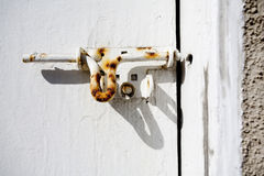 Rusty bolt on door Stock Image