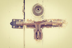 Rusty bolt and doorknob on wooden door (vintage style) Royalty Free Stock Photo