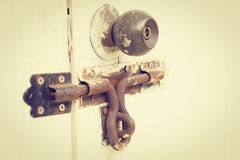 Rusty bolt and doorknob on wooden door (vintage style) Royalty Free Stock Images