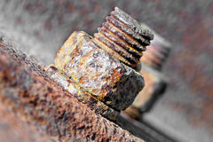 Rusty bolt with nut. Stock Photos