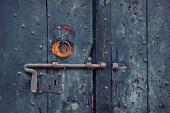 Rusty bolt on old wooden door. Stock Images
