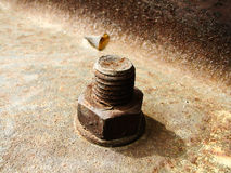 Rusty bolt. A rusty bolt (screw) and nut at the abandoned factory Royalty Free Stock Image