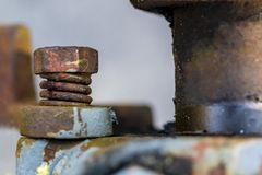 Rusty bolt and spring, macro side view. Stock Photos