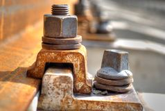 Rusty bolt from trolley track Royalty Free Stock Images