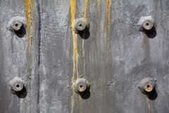 Rusty bolts. On painted metal plate Stock Photography