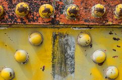 Rusty bolts in a bridge. Yellow bridge showing some rusty bolts ancient and very old royalty free stock photography