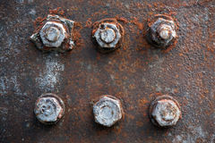 Rusty bolts and nuts. On an old piece of machinery Royalty Free Stock Photos