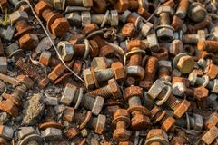 Rusty bolts and nuts. On the floor in the sunlight Royalty Free Stock Photo