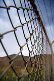 Rusty border fence Stock Photo