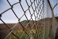 Rusty border fence. In the desert Stock Photos