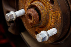 Rusty brake disk and detail of the wheel hub Royalty Free Stock Photos