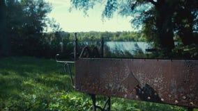 Rusty brazier on the riverside stock video