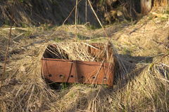 Rusty brazier. The rusty brazier standing in withered grass Stock Image