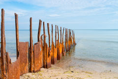 Rusty breakwater with the sea in the background Stock Photos