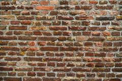 Rusty brick wall of the medieval fortress used as a background royalty free stock photos