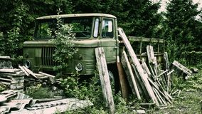 Rusted broken truck in the forest stock images