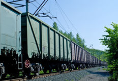 Rusty brown and green freight cars Royalty Free Stock Image