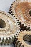 Rusty brown metal gear cogwheels on industrial background. Rusty brown metal gear cogwheels. industrial background Royalty Free Stock Photos
