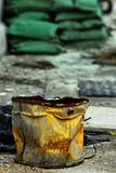 Rusty bucket. Rusty yellow painted bucket on a building site stock images