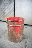 Rusty bucket of red paint Stock Photo