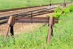 Rusty buffer stop at the end of a railroad track Stock Photos