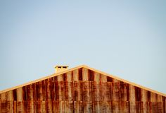 Rusty Building Wall, Roof and Chimney. Copy Space. Clear Day stock image