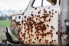 Rusty bullet holes in the door start the truck Stock Photography