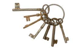 Rusty Bunch of Keys. Dirty old keys isolated on a white background Royalty Free Stock Photo