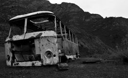 Rusty bus. Old rusty bus in the mountains stock photo