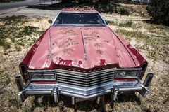 Rusty Cadillac. A rusty cadillac sits in a back yard in Colorado Royalty Free Stock Photo