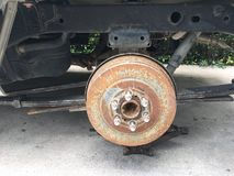 Rusty car axle without wheel Stock Images