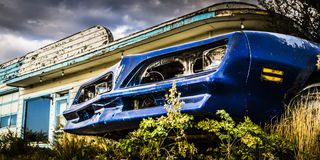 Rusty Car by Gas Station Royalty Free Stock Photos
