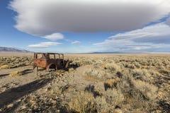 Rusty Car in Nevada Desert. Great Basin, Nevada, USA - October 14, 2016: Vintage rusty car sitting in empty Nevada desert royalty free stock images
