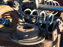 Rusty car parts. Scrap-heap with old rusty parts from cars Royalty Free Stock Photo