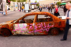 Rusty car. On the road on Independence Square in Kiev is an old rusty car Royalty Free Stock Image