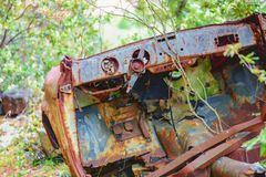 Rusty car wreck abandoned in a wood Stock Image