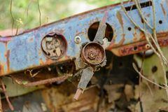 Rusty car wreck abandoned in a wood Stock Photography