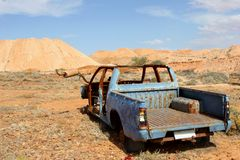Decayed car wreck in the desert, South Australia Stock Images