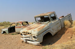 Rusty car wreck at last station in Namib desert Stock Photography