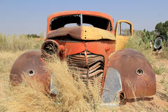 Rusty car wreck at last station in Namib desert Stock Photos