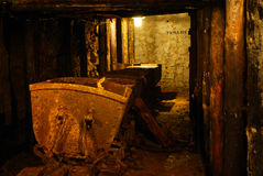 Rusty cart in old mine Royalty Free Stock Photos